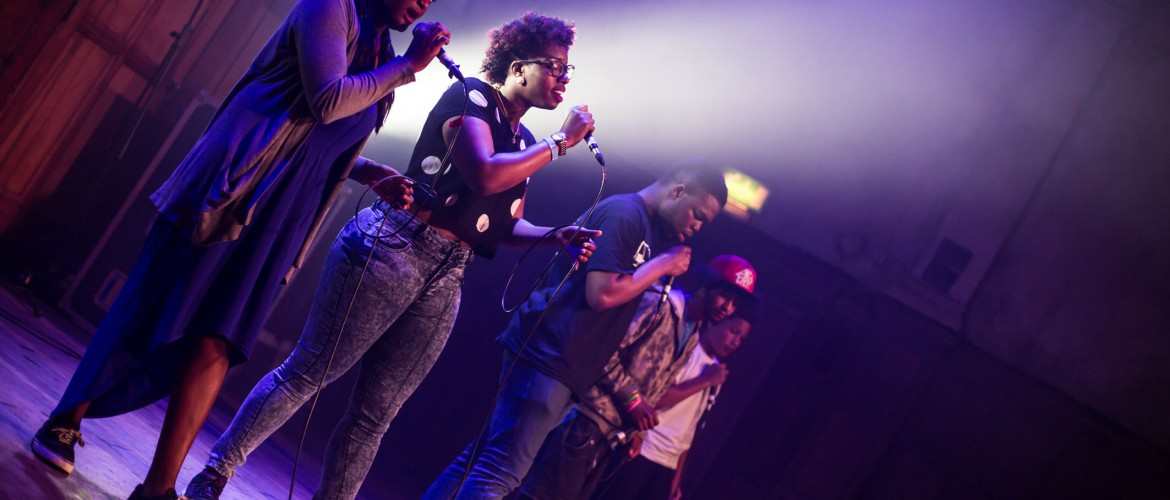 Alt Text: Image of four singers on stage